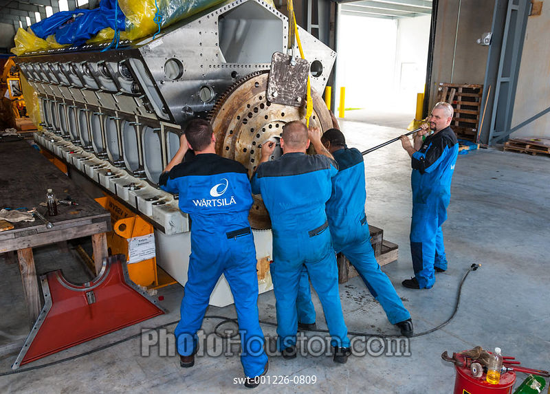 Men working on a Wartsila diesel engine block