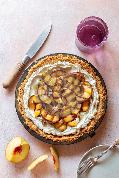 No bake pie with mascarpone cheese, whipped cream and topped with grilled peaches