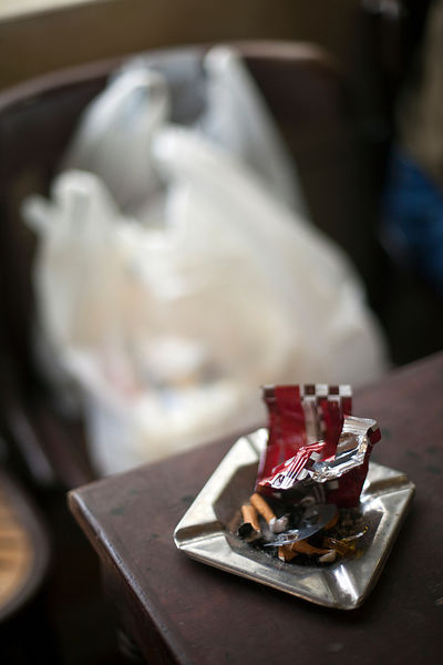 Egypt - Cairo - Details of a full ashtray and bags of shopping at the Telegraph Cafe, off Halim Square