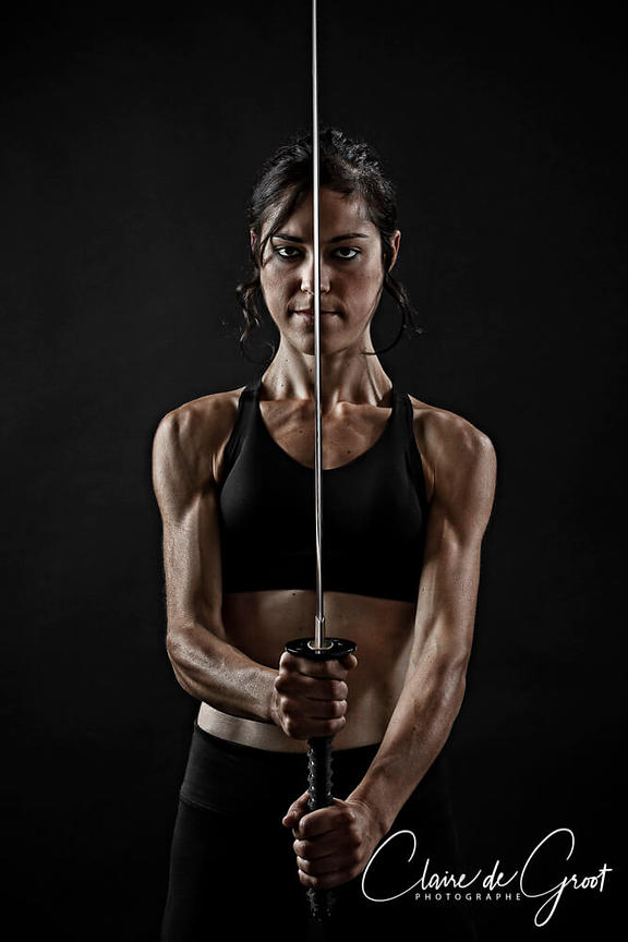 Studio martial arts sports portrait with a Katana