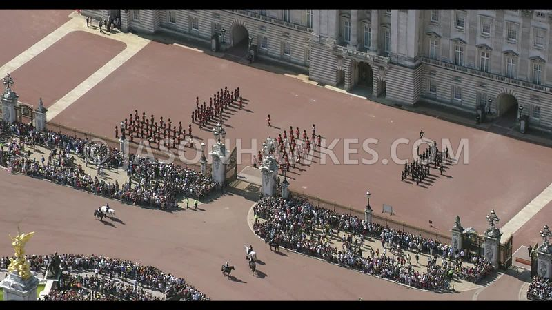 Crowds of people watching changing of the Guard at Buckingham Palace, aerial footage.