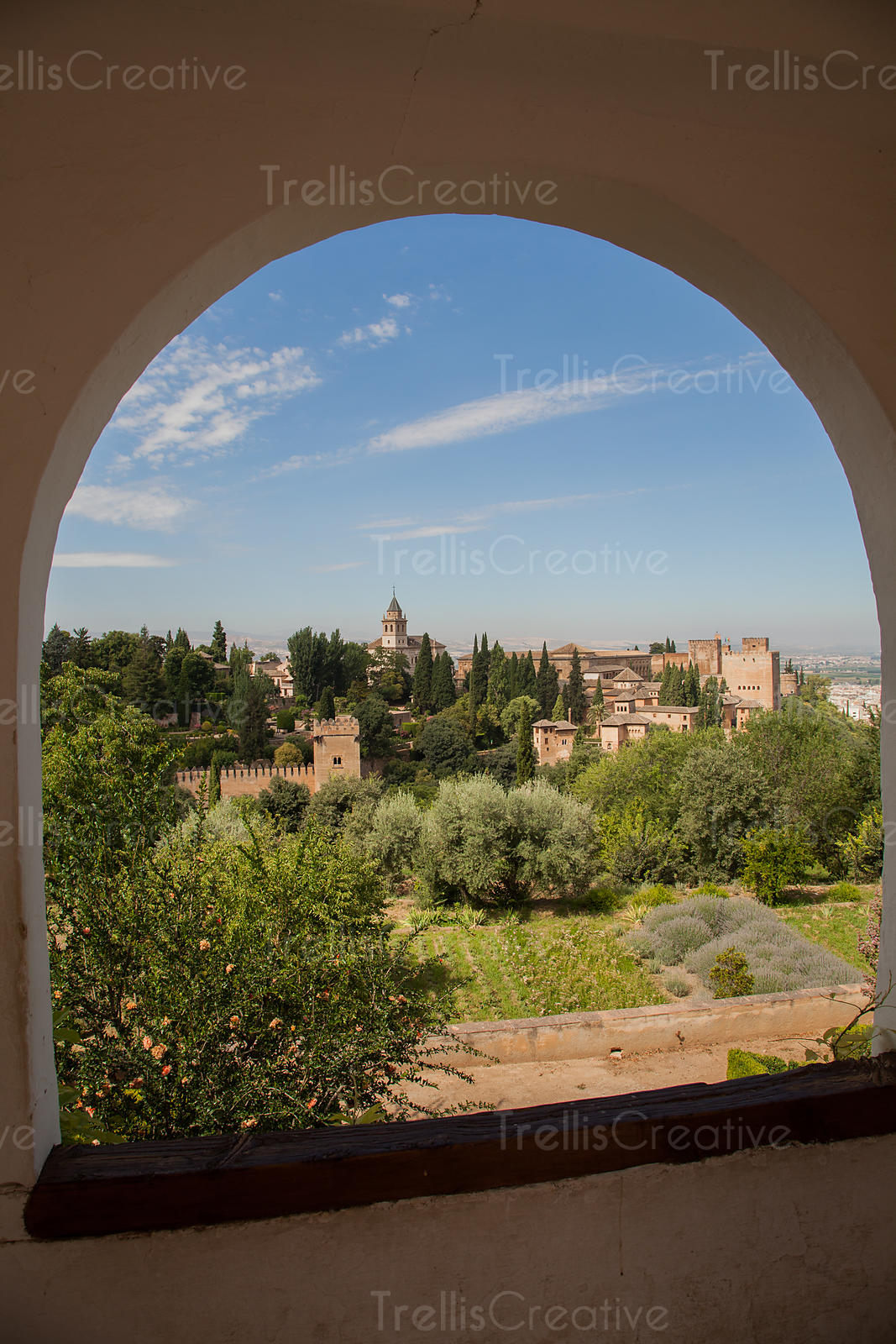 View of the Alhambra through an arched window in Granada, Spain