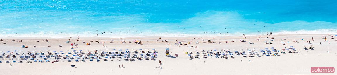 Panoramic of famous Myrtos beach crowded with tourists in summer, Greece