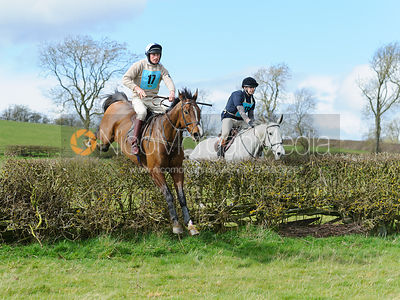 Douglas White and Giles Newton jumping the last hedge - Harborough Ride 2014