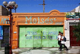 """Jesus, the friend who never fails"" slogan on door of shop, Arica, Region XV, Chile"