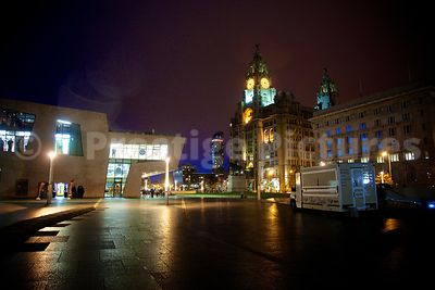 The Mersey Ferry Terminal at Pier Head Liverpool Illuminated at Night with The Royal Liver Building in the Background