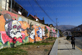 Ñatitas themed mural on concrete wall, La Paz, Bolivia