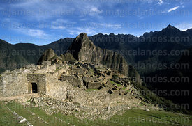 Main entrance to Inca city of Machu Picchu, Huayna Picchu peak in background, Peru