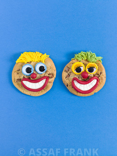 Two face shaped biscuits on blue background