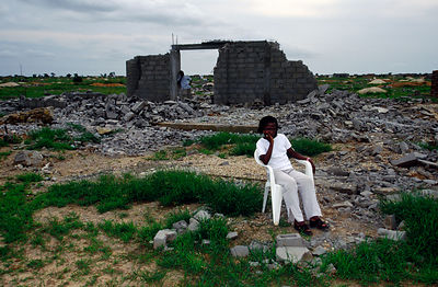 Angola - Luanda - a woman in the ruins of her home