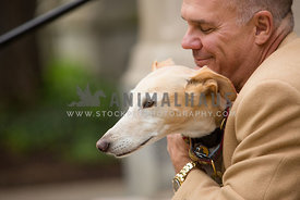 owner hugging dog smiling with eyes closed