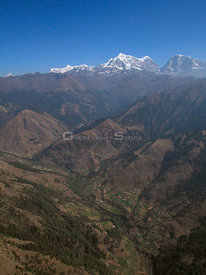 NEPAL Shorong Himal -- 16 Apr 2005 -- Aerial photograph of Mount Numbur (top centre, 6,959m), Mount Khatang (top centre right...