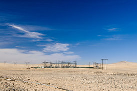 A power substation in an otherwise flat and empty desert