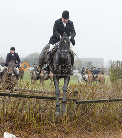Joey Newton jumping a hedge near Pasture Lane