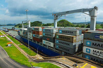 Cargo ship passing through the Panama Canal, Panama City, Panama, Central America. July 2012. All non-editorial uses must be ...