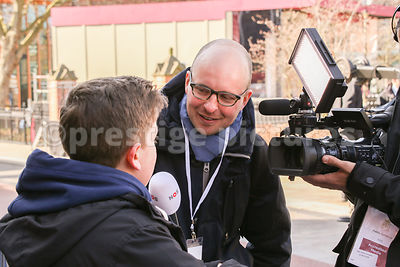 TV Reporter from Dutch TV channel NOS interviewing Young Man