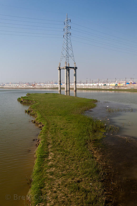 A large electrical transmission line on concrete stilts on the Ganges River, Allahabad, India.