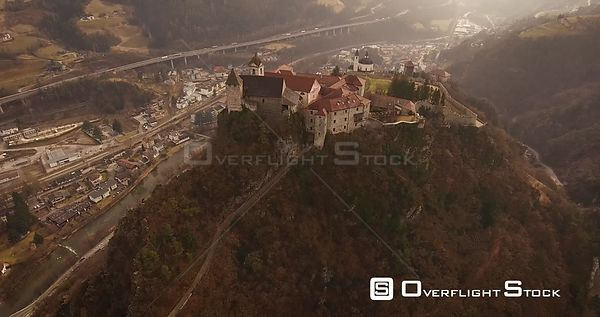 Aerial shot, a small perched town Chiusa in Italy, Sud Tirol, in the middle of the vineyards, 4K
