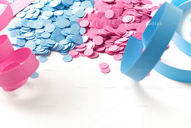 Carnival background of confetti and serpentines pink and blue