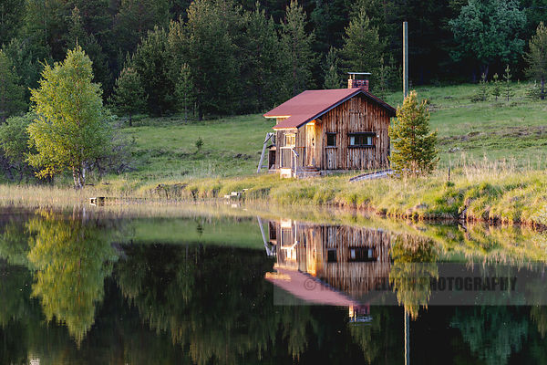 Wooden house on the shore of a lake in Finnish Lapland