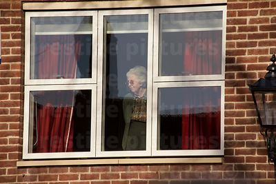 Lady Watching events at the Cathedral from her Upstairs WIndow