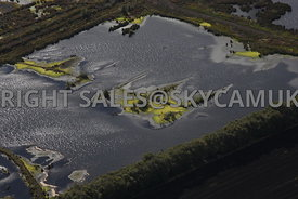 Chat Moss aerial photograph of the Peat beds and the ponds created when peat has been extracted leaving islands surrounded by...