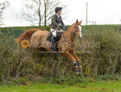 Hattie Towns jumping a hedge above Clawson Thorns