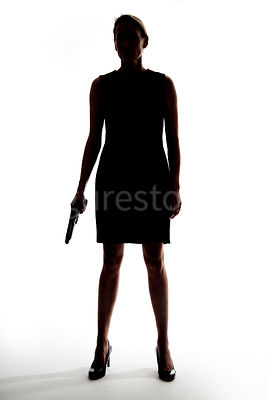 Silhouette of a woman standing with a gun – shot from mid level.