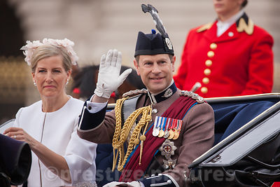 Prince Edward, Earl of Wessex waves to the Crowd as he Rides with his wife Sophie, Countess of Wessex in an open carriage to ...
