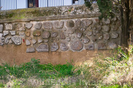 Museum wall made using fragments of roman mosaics, columns and reliefs; Carthage Museum, Tunis, Tunisia; Landscape