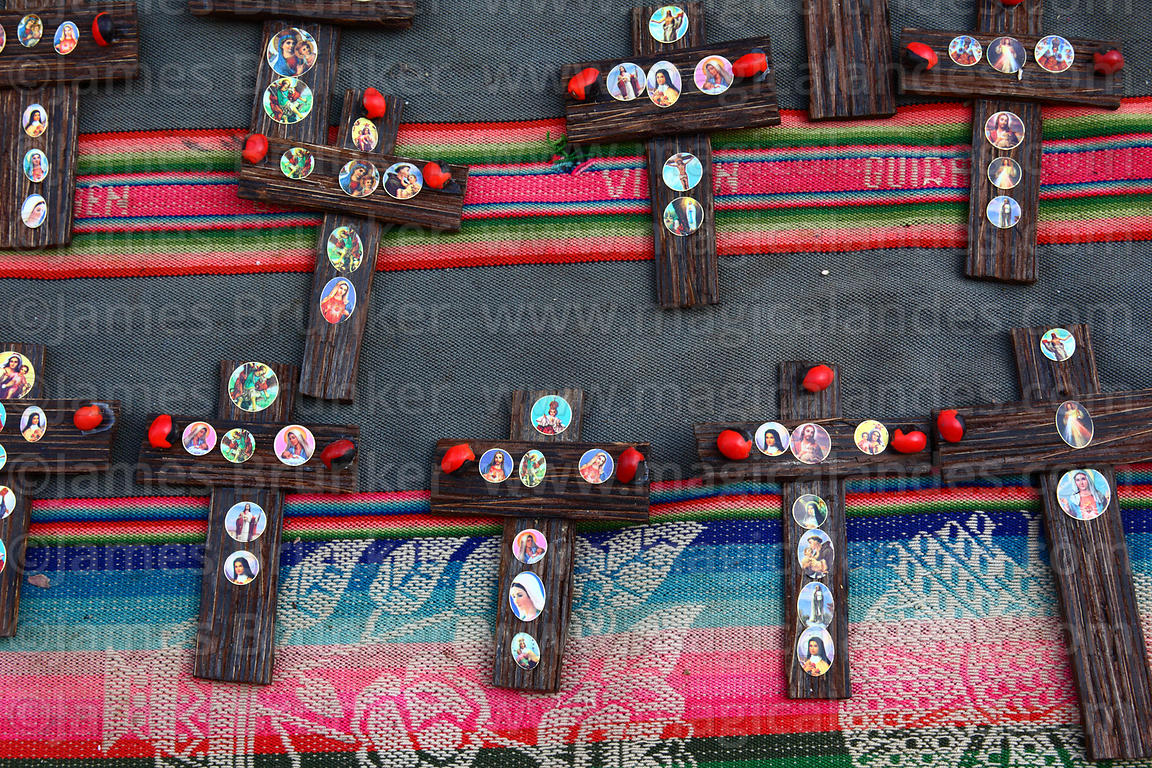 Small wooden crosses for sale for Easter in market , Cusco , Peru