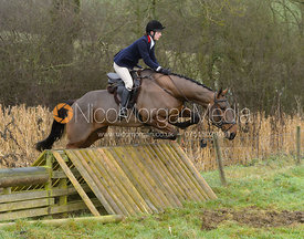 Ida Thore jumping a hunt jump at Peakes - The Fitzwilliam Hunt visit the Cottesmore at Burrough House