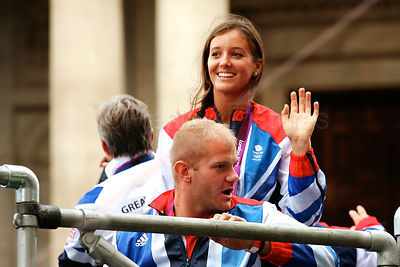 Laura Robson of Team GB waves to the Crowd in the Athletes Victory Parade ugh the Streets of London