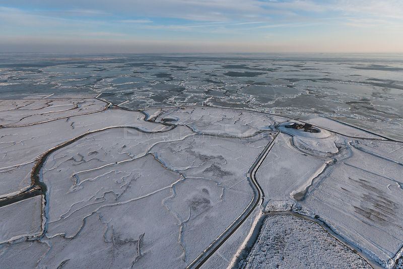 Aerial view of Neuwarft on Hallig Island Nordstrandischmoor, in winter with snow and ice on the Wadden Sea, Schleswig-Holstei...