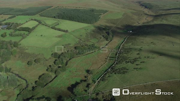Aerial view tracking towards Wistman's Wood, Dartmoor National Park, Devon, England, UK, October 2015. Dartmoor National Park...