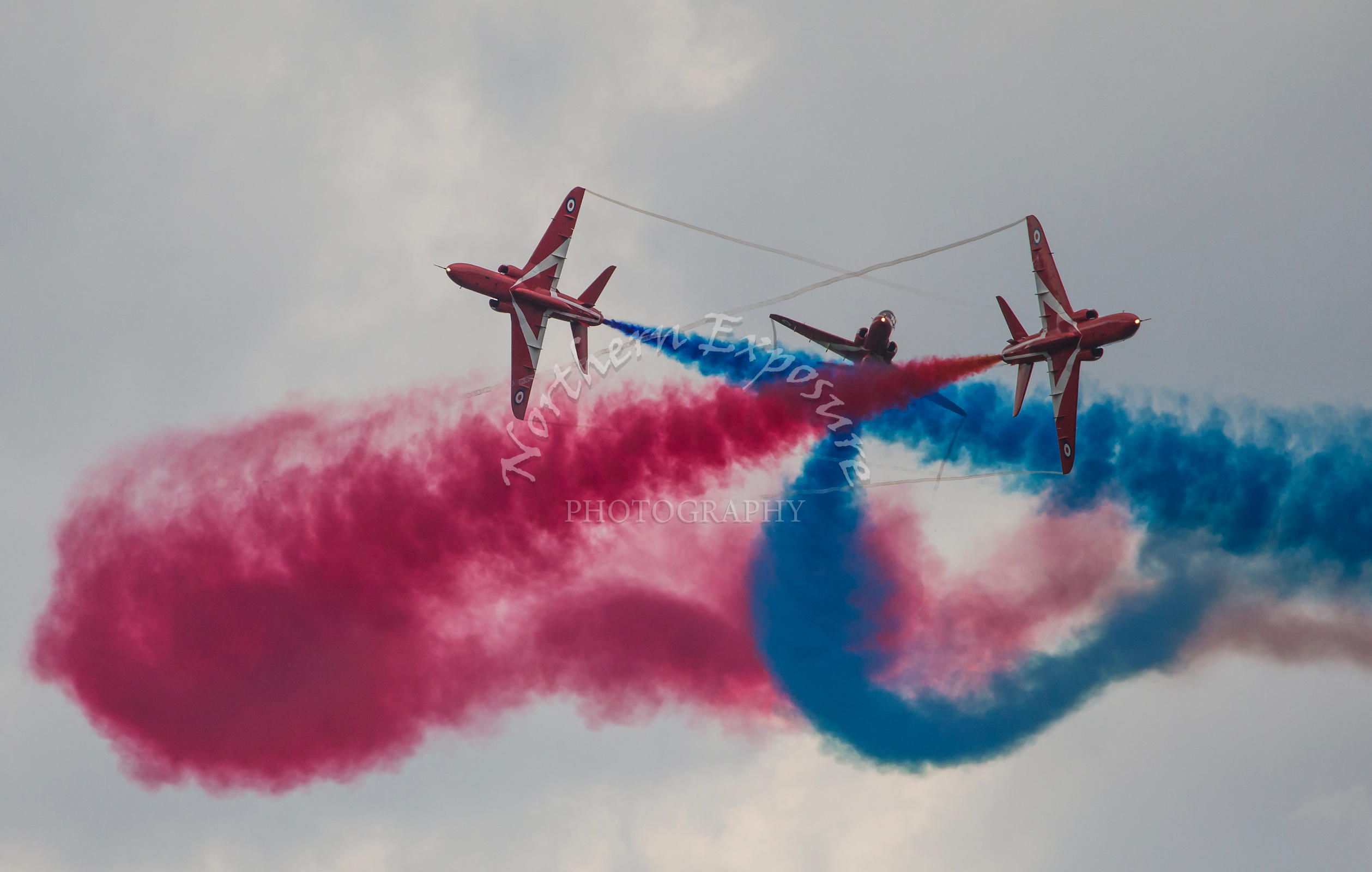 The Red Arrows RAF display team during a formation pass showing smoke while performing at the Battle of Britain 75th Anniversary airshow at Biggin Hill in Kent, England