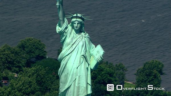 Close flight past Statue of Liberty to zoom-out.