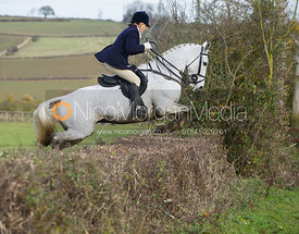 Joanne Rutter jumping a hedge at Town Farm
