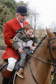 A young supporter with the huntsman Andrew Osborne MFH