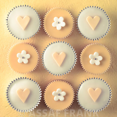 Cupcakes with flower and heart shaped decorations