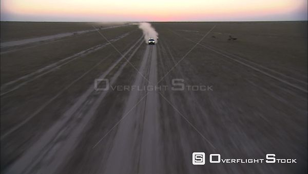 Aerial shot of a car driving across the Makgadikgadi Pan Okavango Delta Botswana