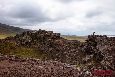 Boy looking at volcano crater, Snaefellsnes, Iceland