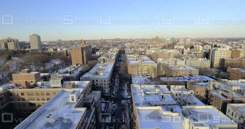 Aerial Over Snow Covered Soccer Football Fields Trees Rooftops Winter Day Brooklyn Prospect Park NYC