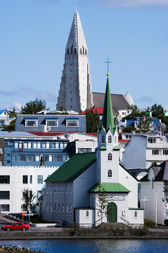 Iceland, Reykjavik, churches and other buildings along Tjornin Lake