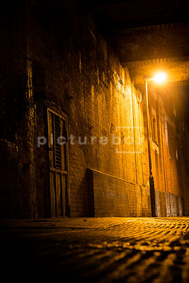 A dark London street at night.
