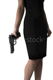 A crop of a woman in a black dress holding a gun – shot from mid level.