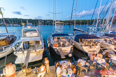 Elevated view of harbor at night with people eating out. Fiskardo, Kefalonia, Greece