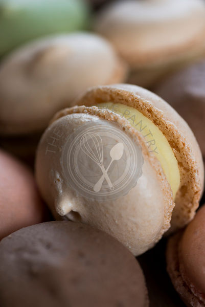 Macarons, a sweet meringue-based confection made with eggs, icing sugar, granulated sugar, almond powder or ground almond, an...