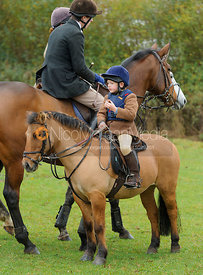 A young supporter on their pony