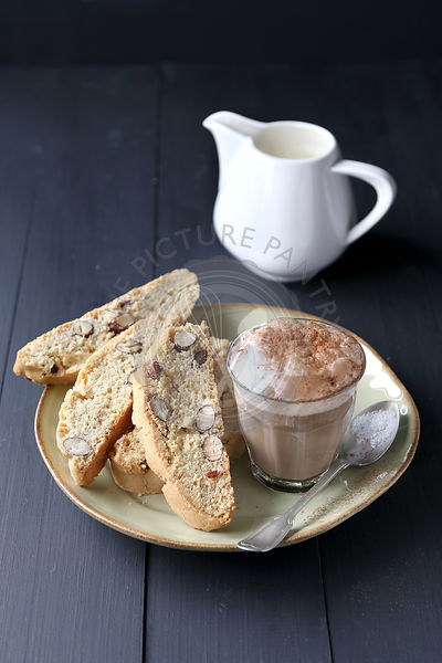 Italian biscotti on plate with a cup of coffee